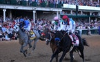 Medina Spirit (far right), ridden by John Velazquez, raced towards the finish line at the Kentucky Derby on May 1.