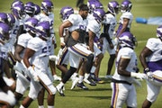 Minnesota Vikings linebacker Anthony Barr (55) with no helmet. and teammates ran through a series of warmup drills.] Jerry Holt •Jerry.Holt@startrib