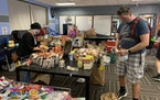 Chris Foreman, 47, of Apple Valley brought his two teenage daughters to Little Earth in Minneapolis on June 2, 2020 to volunteer to sort food for the