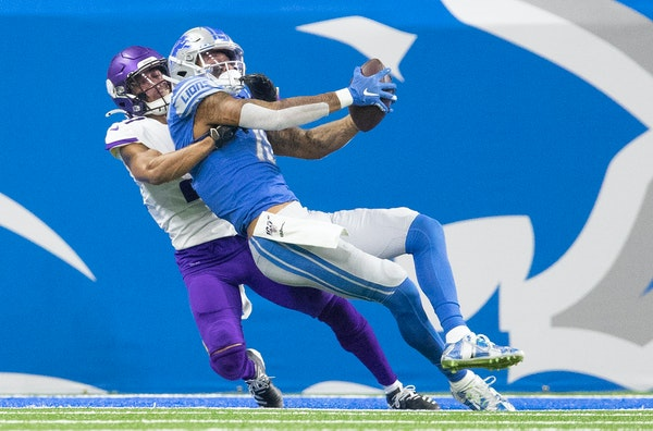 Mike Hughes of the Vikings broke up a pass intended for Detroit's Kenny Golladay in a game at Ford Field in 2019.