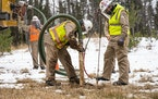Enbridge utility contractors worked to identify and mark an older Enbridge pipeline, Line 16, at one of the Line 3 work sites in Carlton. (Alex Korman
