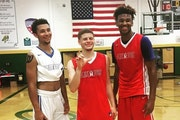 Payton Willis (left) and Eric Curry (right) played AAU basketball for the Arkansas Wings, along with Tyrik Dixon (middle) who went on to play for Midd