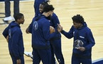 Minnesota Timberwolves forward Anthony Edwards (1) high fived center Karl-Anthony Towns (32) after a presentation naming Edwards the Rookie of the Mon