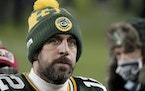 Green Bay Packers quarterback Aaron Rodgers (12) walks off the field after the NFC championship game loss to Tampa Bay.