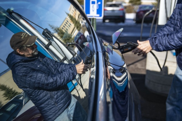 In this file photo, a Tesla owner charges his car at the ChargePoint charging station near Canal Park Lodge in Duluth in November 2019. ALEX KORMANN �