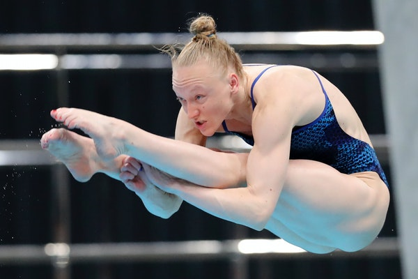 Bacon Sarah performs a dive during the women's 3-meter springboard final at the FINA Diving World Cup in Tokyo on Tuesday