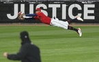 Twins center fielder Byron Buxton made a diving catch on a ball hit by Rangers left fielder David Dahl in the top of the seventh inning.