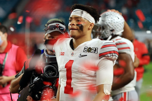 In this photo from January 11, 2021, Justin Fields (1) of the Ohio State Buckeyes leaves the field following the College Football Playoff National Cha