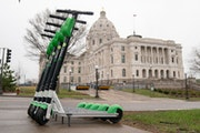 Lime scooters across the street from the Minnesota State Capitol on the corner of University Ave and  Martin Luther King Jr Blvd.     ] GLEN STUBBE �