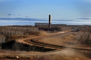 FILE-The half-built Mesabi Metallics taconite mine project in Nashwauk, Minn., in 2014. The Minnesota Department of Natural Resources is pulling state