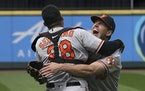 Orioles starting pitcher John Means hugs catcher Pedro Severino after Means threw a no-hitter in the team's game against the Mariners