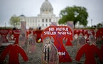 An art installation from Artists C3 was placed in front of the Minnesota Capitol lawn to represent and honor Native relatives who have been lost.