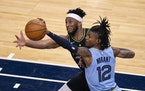 Memphis Grizzlies guard Ja Morant (12) stole a second quarter pass intended for Minnesota Timberwolves forward Josh Okogie (20).