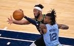 Memphis Grizzlies guard Ja Morant (12) stole a second quarter pass intended for Minnesota Timberwolves forward Josh Okogie (20).