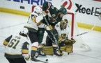 Vegas defenseman Shea Theodore and Wild left wing Jordan Greenway fought for the puck at Vegas' net in the second period.