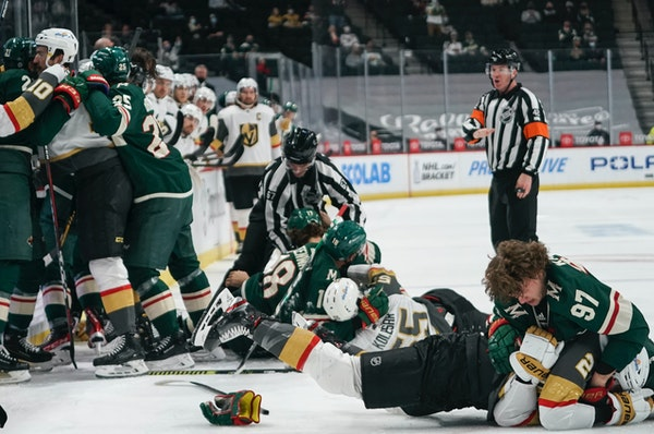 Wild rookie Kirill Kaprizov got tangled up with Vegas' Zach Whitecloud in the first period of Wednesday's game at Xcel Energy Center.