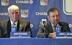 FILE - John Davidson, left, and James Dolan, owner of the New York Rangers, participate in a news conference in New York, in this Wednesday, May 22, 2