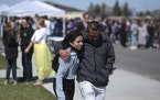People embrace after a school shooting at Rigby Middle School in Rigby, Idaho on Thursday, May 6, 2021. Authorities say a shooting at the eastern Idah