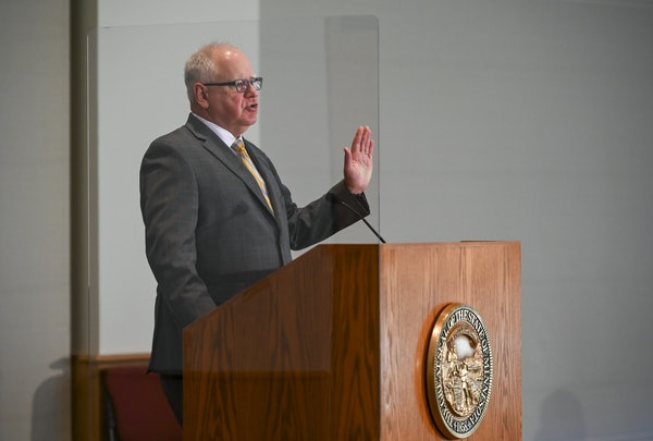 "After a year of mostly grim gubernatorial updates about COVID-19, Gov. Tim Walz expressed relief on Thursday: ""We're here, we're here, we're h"