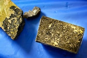 Flecks of ore containing copper, nickel, cobalt, palladium, platinum and gold seen in core samples taken from around PolyMet property.