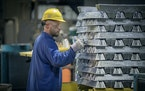 In this file photo from 2018, a Spectro Alloys company worker sorted and recycled aluminum scraps into solid ingots. ELIZABETH FLORES • liz.flores@s