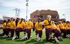 University of Minnesota photo The Gophers surrounded coach Piper Ridder before an April game against Purdue.