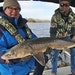 David Whitescarver of Golden Valley, left, and Scott Ward of Inver Grove Heights held a  a 51-inch sturgeon caught and released late last week east of