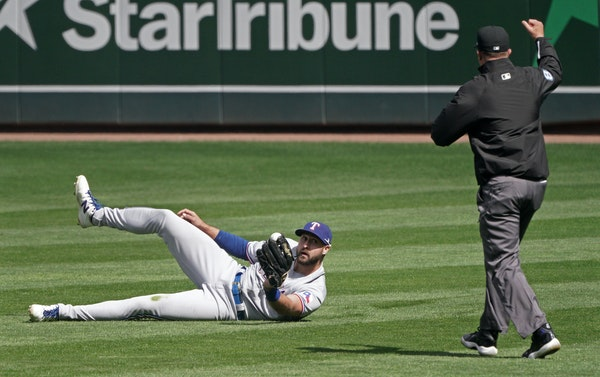 Texas right fielder Joey Gallo made a diving catch on a Miguel Sano's liner the 10th inning to end the game.