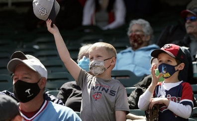Twins fans like friends Jake Renner, 6, and Cameron Leapaldt, 5, from Chanhassen, will be happy to hear about the lifting of COVID-19 restrictions inc