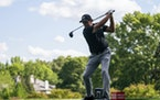 Phil Mickelson tees off on the seventh hole during the first round of the Wells Fargo Championship