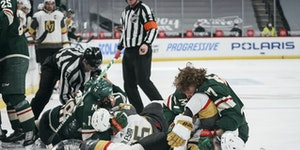 Wild rookie Kirill Kaprizov (97) and Vegas Golden Knights defenseman Zach Whitecloud (2) fought on the ice in the first period Wednesday night.