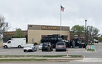 Two police vehicles were in front of the Wells Fargo bank during a robbery where hostages are being held in St. Cloud, Minn., on Thursday, May 6, 2021