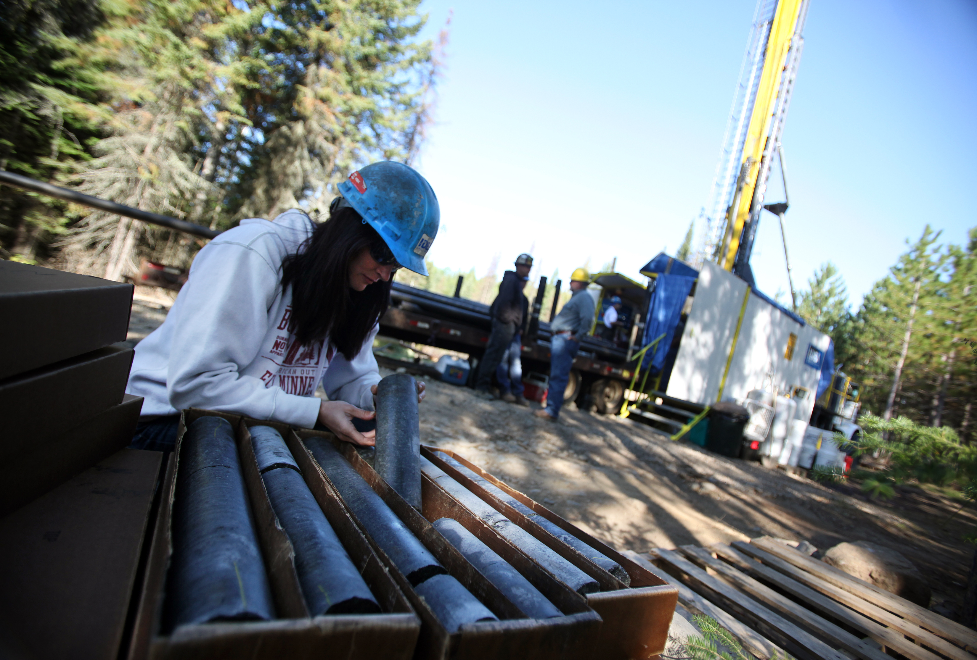 Geologist Gina Raymond looked at the metal content of freshly drilled core at a drilling site near Ely, Minn. in 2011.