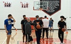 D1 Minnesota coach Joe Burger conducts practice with Cam Heide, Kendall Blue, Josh Ola-Joseph and Taison Chatman (left to right).