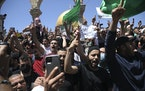 Worshippers chant slogans and wave Hamas flags during a protest against the likely evictions of Palestinian families from the homes, after the last Fr