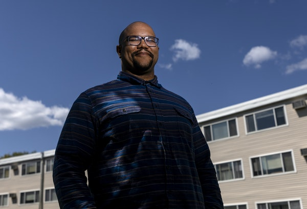 Cameran Bailey photographed at the Minnetonka Heights apartments. Bailey is one of two Met Council employees who created and launched the organization