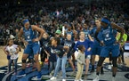 The Lynx players, including forward Napheesa Collier, left, did a post-game victory dance with young fans after a game in 2019.