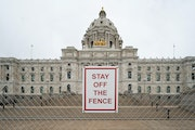 Fencing remains around the Minnesota State Capitol, as one week remains for the Legislature to compromise on a roughly $52 billion state budget and fi