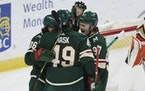 Minnesota Wild's Victor Rask (49) celebrates with teammates Mats Zuccarello (36) and Kirill Kaprizov (97) after scoring a goal against the Anaheim D