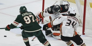 Kirill Kaprizov shoots the puck into the net against Ducks' goalie John Gibson to win in overtime on Friday night.