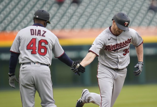 Kyle Garlick got a quick handshake from third base coach Tony Diaz after leading off Friday night's game at Detroit with a home run. The game was no
