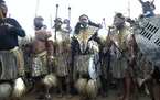 Prince Misuzulu Zulu, centre, flanked by fellow warriors in traditional dress at the KwaKhangelamankengane Royal Palace, during a ceremony, in Nongoma