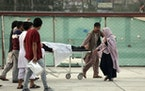 An injured student is transported to a hospital after a bomb explosion near a school west of Kabul, Afghanistan, Saturday, May 8, 2021.