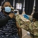 Michael Elder of St. Paul got a COVID-19 vaccine shot last month from Lydia Payne, a senior airman in the Air Force, at the Minnesota State Fairground