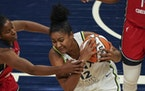 Minnesota Lynx forward Damiris Dantas (12) fought to keep the ball in the second half.