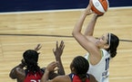 Minnesota Lynx forward Natalie Achonwa (11) shot the ball in the first half.