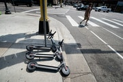 Three Bird scooters were on the sidewalk at 9th and Hennepin in downtown Minneapolis.        ] GLEN STUBBE • glen.stubbe@startribune.com   Tuesday,