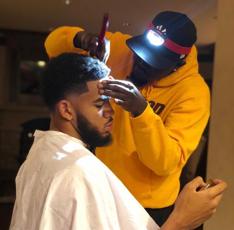 Akeem Akway cutting Karl-Anthony Towns' hair in October, 2018.