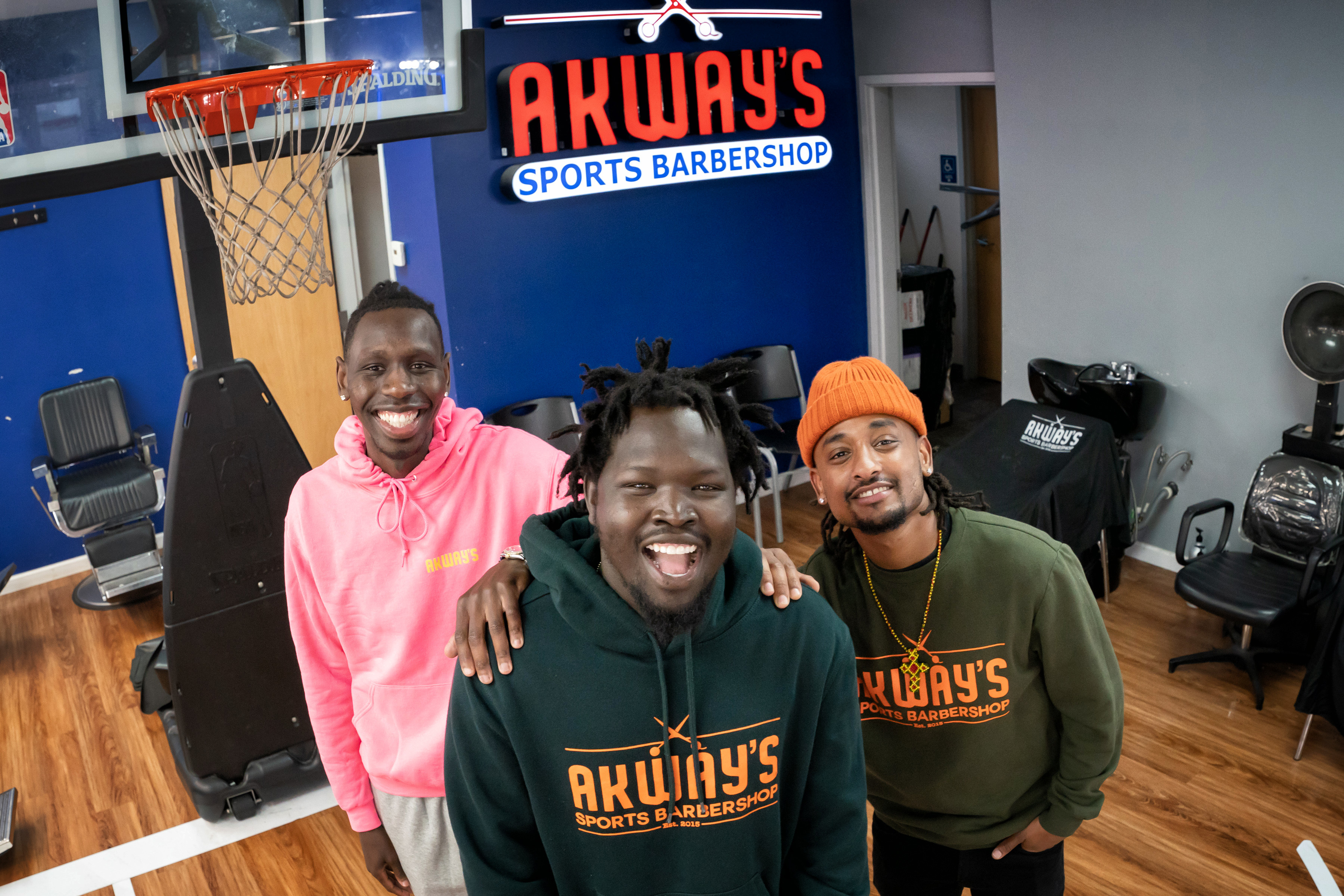 Akeem Akway, owner, Akway's Sports Barbershop in Mounds View, with cousins and business partners Amane Akane, left, and Nathan Sheferaw, right.