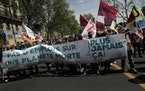 "Protesters hold a banner reading ""No jobs on a dead planet"" during a rally against climate change in Paris, Sunday, May 9, 2021."